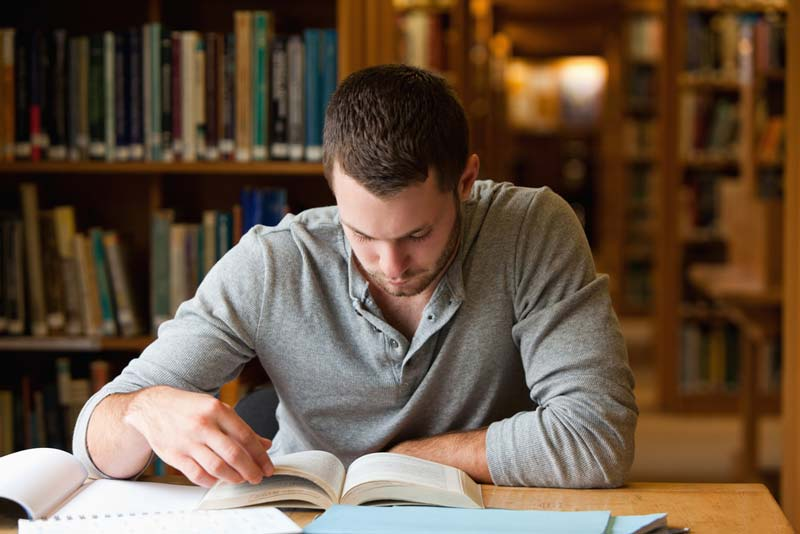 Student studying in a library